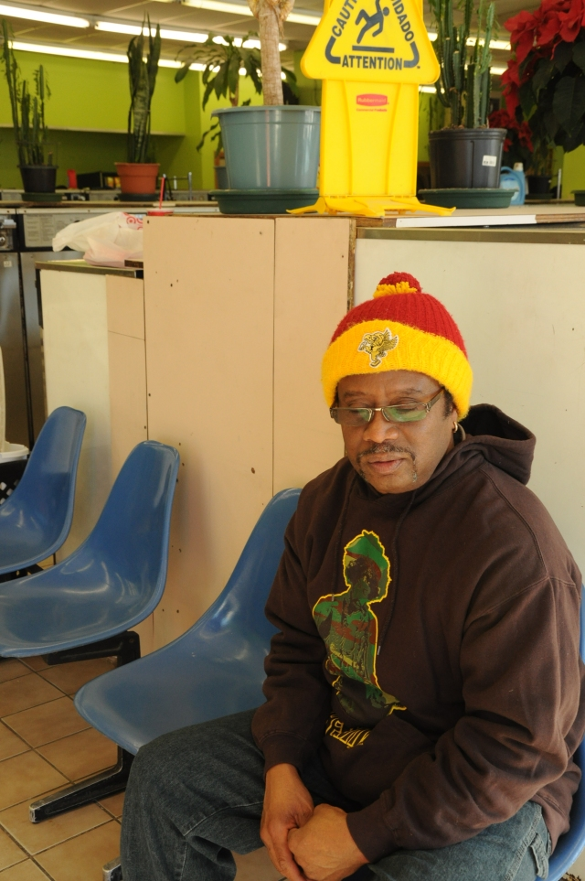 "Belize-native Dennis Thompson moved to Rogers Park in 1991. Though Econo Coin laundromat isn't the closest one to his house, he prefers the friendly, clean atmosphere of this one. Thompson left Belize over 30 years ago. Though he hasn't been able to find a steady job, he currently works as on the dock, loading and unloading shipping containers. ""I go where the money is,"" he says."